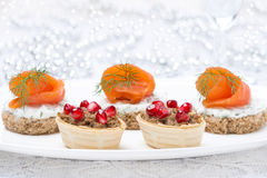 Holiday appetizers - canape with salmon and tartlet with pate Stock Image