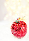Holiday Apple  bauble on white snow Christmas lights and copy sp Royalty Free Stock Image