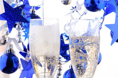 Holiday background. Glass of fizz on the white Royalty Free Stock Images