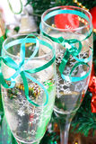 Holiday background. Glass of fizz on the table Stock Photos