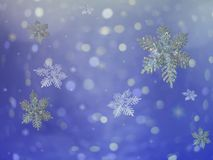 Holiday background. A winter holiday snowflake background Stock Photos