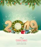 Holiday background with a 2019 and christmas wreath. vector illustration