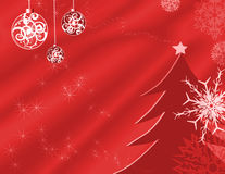 Holiday background. Illustration with stars, ornaments, snowflakes and a tree on red Stock Image