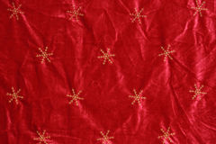 Holiday Background. A background of red velvet and snowflakes for the holidays royalty free stock photography
