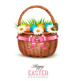 Holiday background with basket full of Easter eggs. Stock Photo