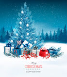 Holiday background with a blue Christmas tree and presents. Royalty Free Stock Photo