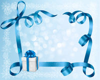 Holiday background with blue gift bow with gift bo Stock Photo