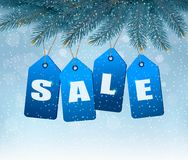 Holiday background with blue sale tags. Stock Photos
