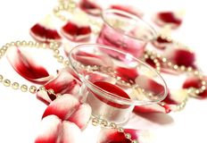 holiday background of candles and petals Royalty Free Stock Image