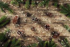 Holiday background of Christmas fir branches, spruce, juniper, fir, larch, pine cones with snowflakes. Xmas and New Year theme. Flat lay, top view stock illustration