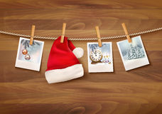 Holiday background with christmas photos and a santa hat. Royalty Free Stock Image