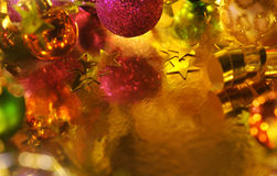 Holiday Background. Holiday Christmas background with reflections on gold paper Stock Images