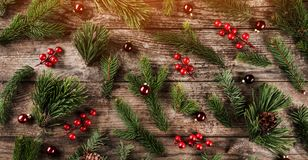 Holiday background of Christmas tree branches, spruce, juniper, fir, larch, pine cones, berries and balls. Xmas and New Year theme. Flat lay, top view stock images