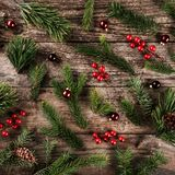 Holiday background of Christmas tree branches, spruce, juniper, fir, larch, pine cones, berries and balls. Xmas and New Year theme. Flat lay, top view royalty free stock image