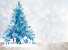 Holiday background with a Christmas tree and presents. vector illustration