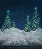 Holiday background with Christmas trees in snow Stock Photo