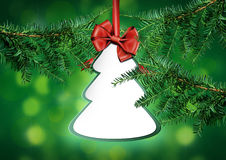 Holiday background with fir twigs and paper invitation card Stock Image