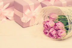 Holiday background with flowers, gift and silky ribbon Royalty Free Stock Photo