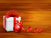 Holiday background with gift box. And red ball. Vector illustration Stock Image