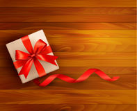 Holiday background with gift box and red ribbons Royalty Free Stock Image