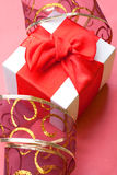 Holiday background with gift box. Holiday background with gift box and red ribbons. Still life Royalty Free Stock Photos