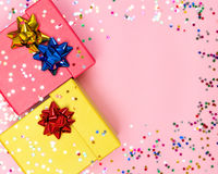Holiday background of gift boxes, wrap bows and confetti Royalty Free Stock Photos