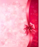 Holiday background with gift pink bow and ribbon. Royalty Free Stock Images