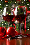 Holiday background with glasses of red wine royalty free stock photos