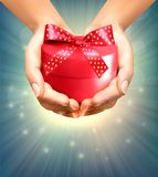 Holiday background with hands holding gift box. Royalty Free Stock Photos