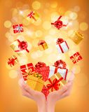 Holiday background with hands holding gift boxes. Royalty Free Stock Images