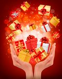 Holiday background with hands holding gift boxes Royalty Free Stock Photography