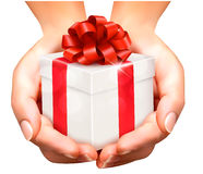 Holiday background with hands holding gift boxes. Concept of giv Royalty Free Stock Photo