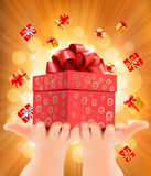 Holiday background with hands holding gift boxes. Concept of giv Royalty Free Stock Images