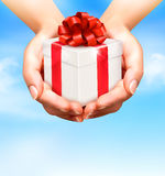 Holiday background with hands holding gift boxes. Stock Photography