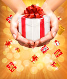 Holiday background with hands holding gift boxes. Royalty Free Stock Image