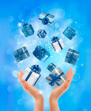 Holiday background with hands holding gift boxes.  Royalty Free Stock Photography