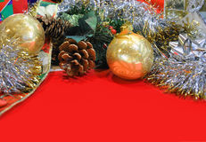 Holiday Background Header with Copyspace. A holiday Christmas header or banner with a red background. Add your text in the copyspace below. Tinsel, an acorn, a Stock Photos