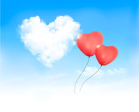 Holiday background with heart shape of cloud on blue sky Stock Photo