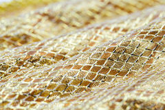 Holiday background image of gold sparkly mesh ribbon Stock Images