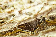 Holiday background image of gold sparkly mesh ribbon Royalty Free Stock Photos