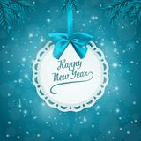 Holiday background with a label and a blue ribbon with bow. Fir branches frame. Vector Illustration Stock Image