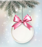 Holiday background with a label and a bow. Royalty Free Stock Photography