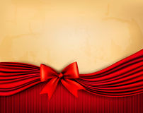 Holiday background with old paper and red gift bow Royalty Free Stock Image
