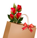 Holiday Background With Paper Shopping Bag with Bouquet Stock Image