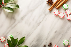 Holiday background with peppermint candy. And spices on marble Stock Images