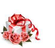 Holiday background with pink roses and gift box. Stock Photos