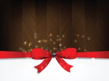 Holiday background with a red bow and wood. Stock Image