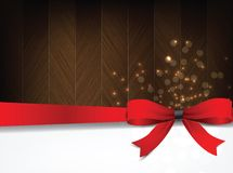Holiday background with a red bow and wood. Stock Photos