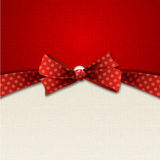 Holiday Background  with red polka dot bow Royalty Free Stock Photography
