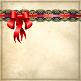 Holiday background with red ribbon on old paper Stock Images